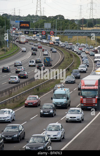 Variable speed limit section of the M42 showing traffic using the hard shoulder in attempt to ease congestion at - Stock Image