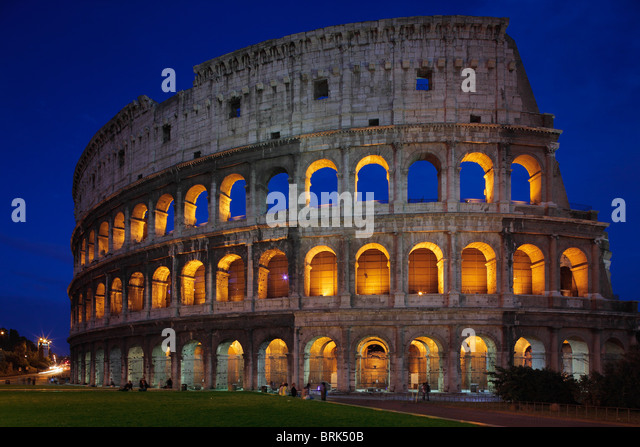 The Colosseum, or Roman Coliseum, in Rome, Italy is lit up at night - Stock Image