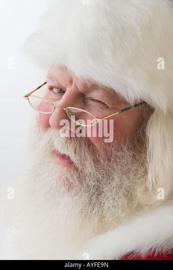Close up of Santa Claus winking - Stock Image