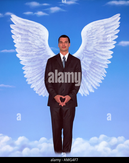 A portrait of young man in a business suit and wings against blue sky - Stock-Bilder