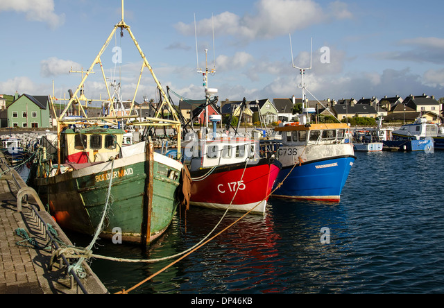 Colorful fishing boats in Dingle Harbout, Dingle Peninsula, Ireland. - Stock Image