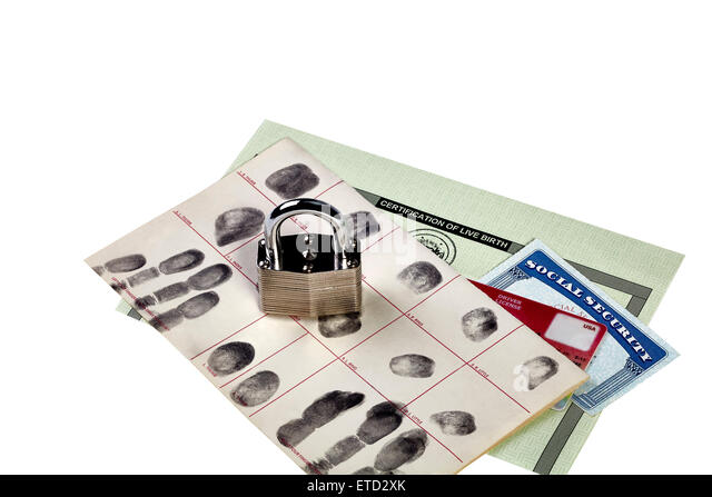 Fingerprint card, driver's license, social security card and birth certificate with locked padlock isolated - Stock Image