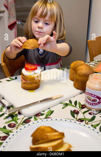 Girl making layer cake - Stock Image