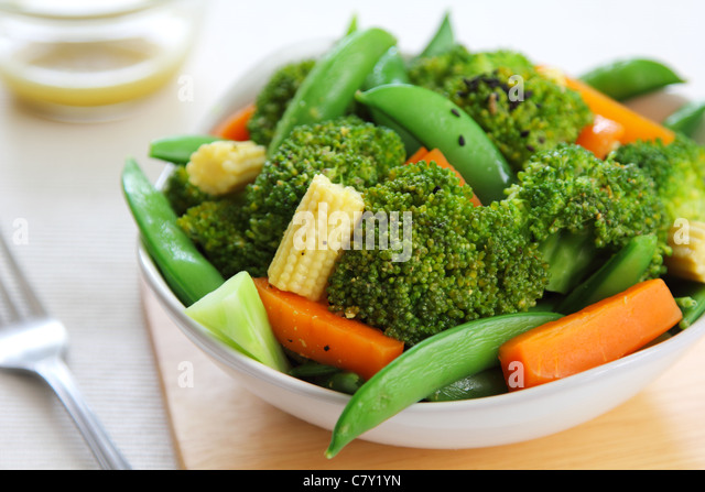 Broccoli salad with carrot ,baby corn and snap pea - Stock Image