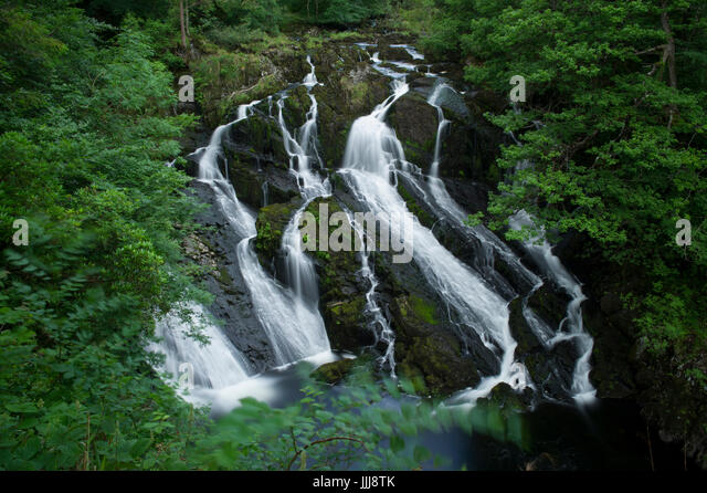 The famous Swallow Falls near Betws-y-Coed in Snowdonia National Park in Wales - Stock Image