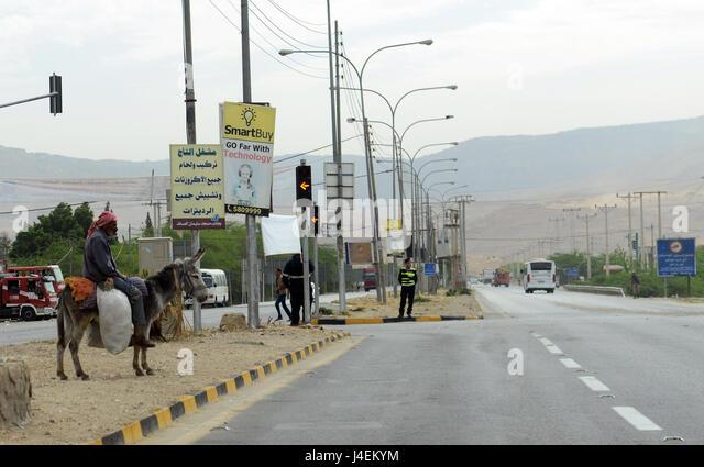Traffic in Jordan's Jordan valley. - Stock Image