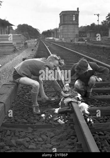 After the ballot vote for the continuation of the strike of the East German State Railway, children play at the - Stock Image
