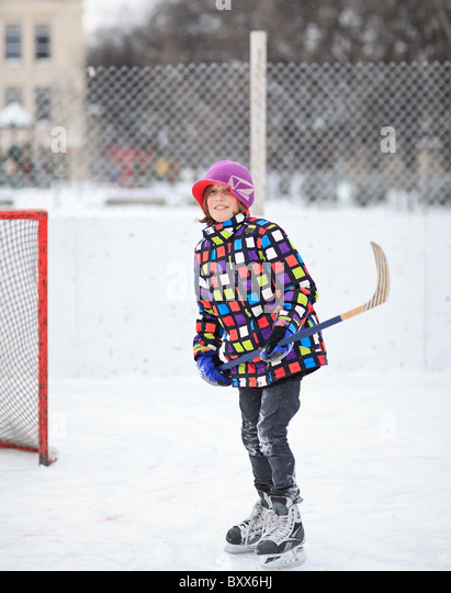 Young boy ice hockey player on an outdoor rink.  Winnipeg, Manitoba, Canada. - Stock Image
