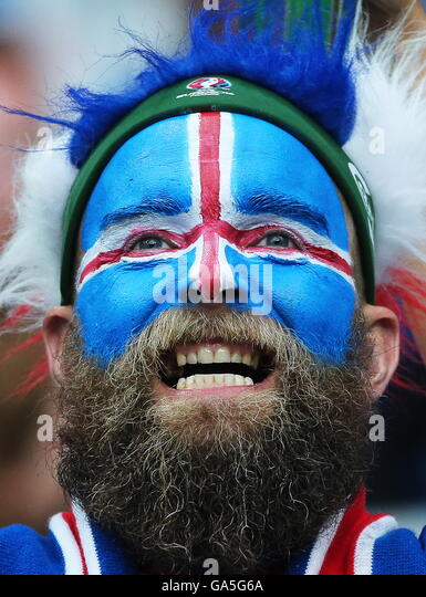 Saint Denis, France. 3rd July, 2016. Iceland's fan with his face covered in the colours of the national flag - Stock Image
