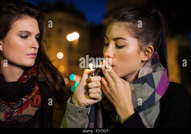 Young women smoking marijuana together - Stock-Bilder