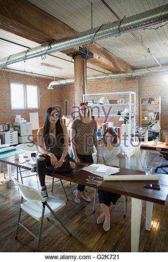 Portrait confident female designers in office - Stock Image
