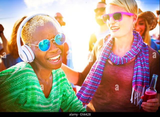 Dancing Beach Summer Happiness Joyful Concept - Stock Image