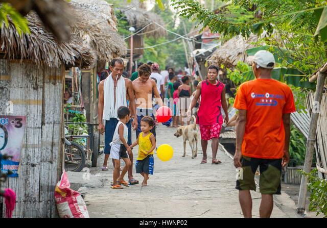Philippines, Luzon, Sorsogon Province, Donsol, small street in fishermen village - Stock-Bilder