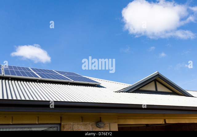 Gable on Colorbond Steel Roof with solar panels - Stock Image