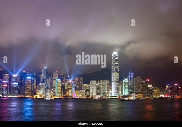 China Hong Kong Skyline viewed from Kowloon at dusk - Stock Image