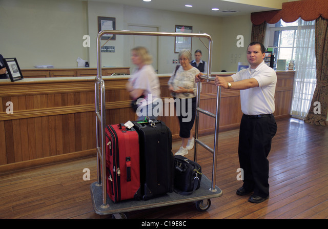 Panama City Panama Amador Country Inn and & Suites hotel lodging business mid-market chain lobby Hispanic man - Stock Image