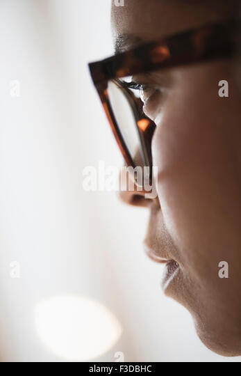 Close up of young woman in nerdy glasses - Stock-Bilder