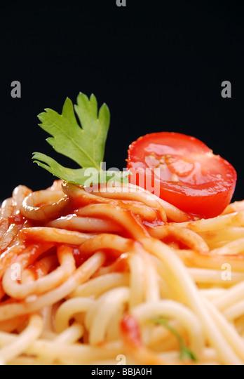 Pasta with tomato sauce close up shot - Stock Image