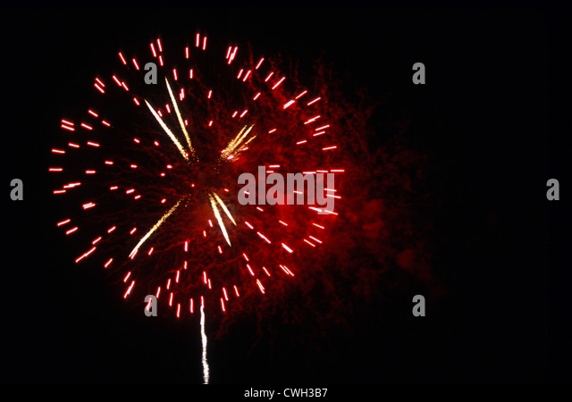 Single Red Firework Explosion - Stock Image