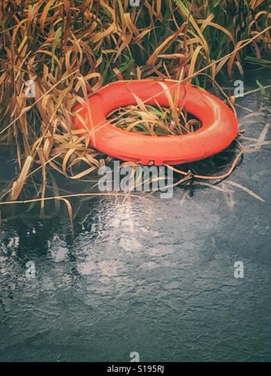 Life buoy on frozen lake - Stock-Bilder