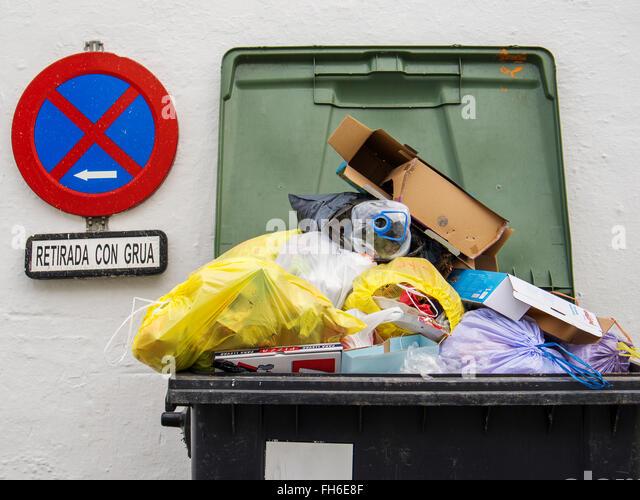 Overflowing Rubbish Bin Dumpster - Stock Image