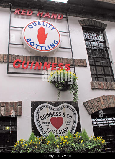Duke Of York Pub,Belfast - Red Hand Guinness sign, extra Stout - Stock Image