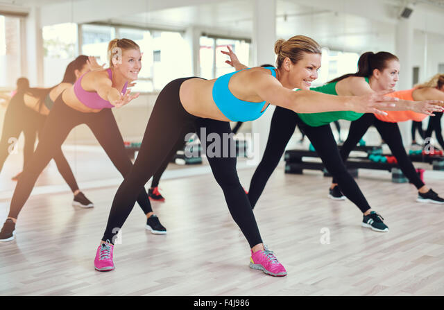 fitness, sport, training, gym and lifestyle concept - group of smiling people exercising in the gym - Stock-Bilder