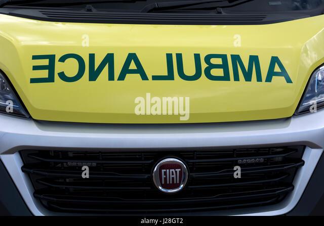 Reversed word on an ambulance, UK - Stock Image