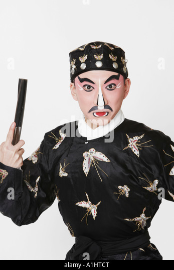 Portrait of a male Chinese opera performer holding a fan - Stock Image