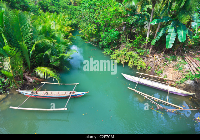 Traditional Philippine boat. Beautiful river. Philippines - Stock Image