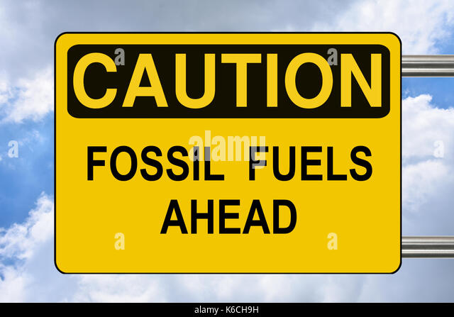 Fossil fuel ahead, yellow warning road sign - Stock Image