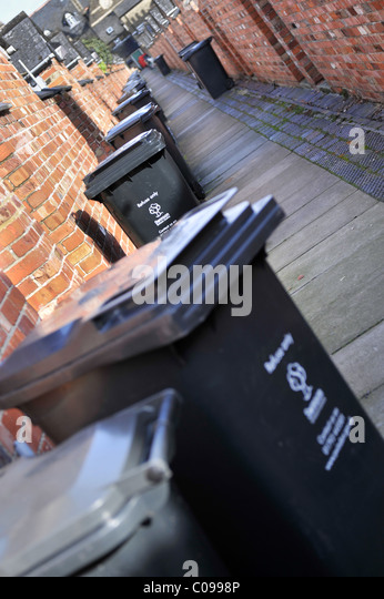 Wheelie bins in a traditional British back alley - Stock Image