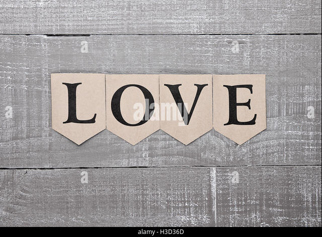 Love letter symbol on wooden board feelings card for present - Stock Image