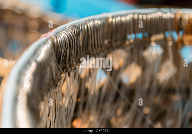 many fishing hooks on the net - Stock Image
