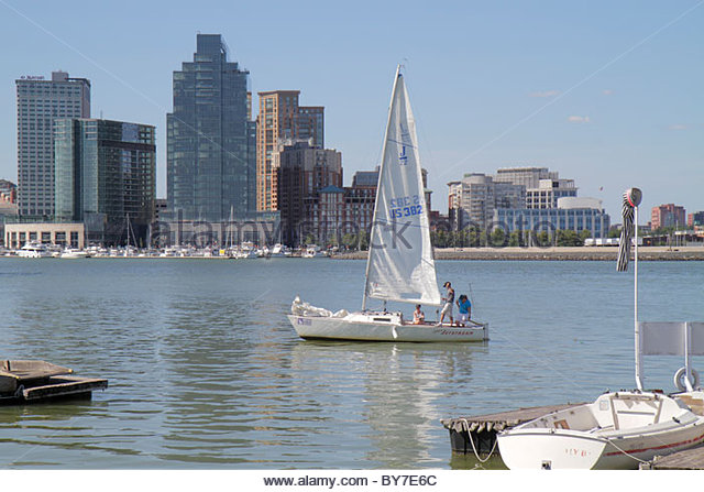 Baltimore Maryland Patapsco River Inner Harbor skyline boating sailboat sailing water sport waterfront - Stock Image