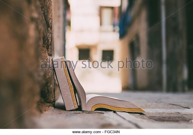 Close-Up Of Open Book On Street - Stock Image