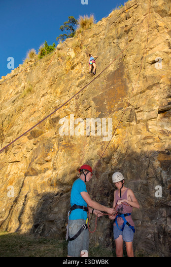 Brisbane Australia Queensland Kangaroo Point Cliffs Count White Park man rock climbing line rope instructor wearing - Stock Image