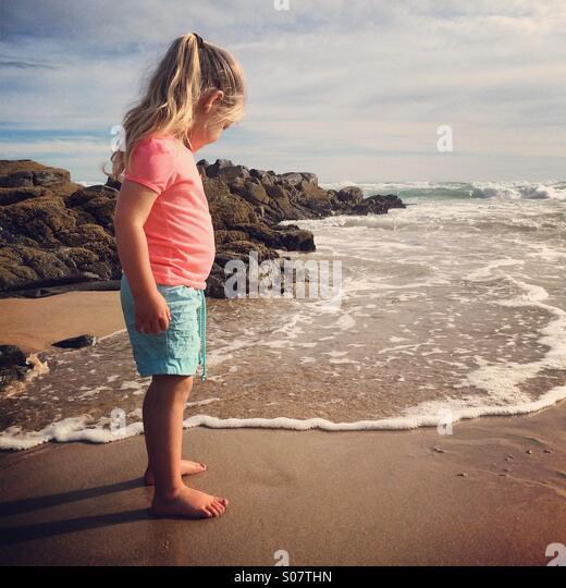 Toddler on beach - Stock Image