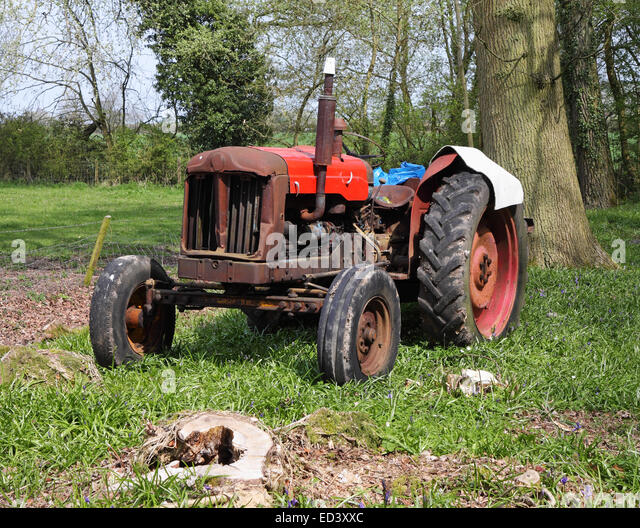 Old Rusty Tractor in an English Woodland Glade in Spring - Stock Image