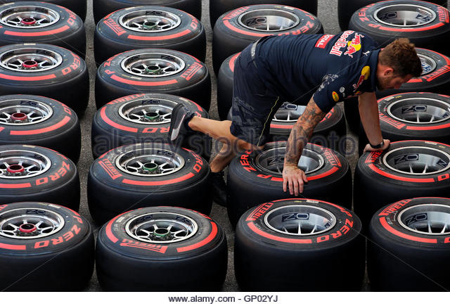 Italian Formula One - F1 - Italian Grand Prix 2016 - Monza, Italy - 01/9/16 - A Red Bull mechanic inspects Pirelli - Stock Image