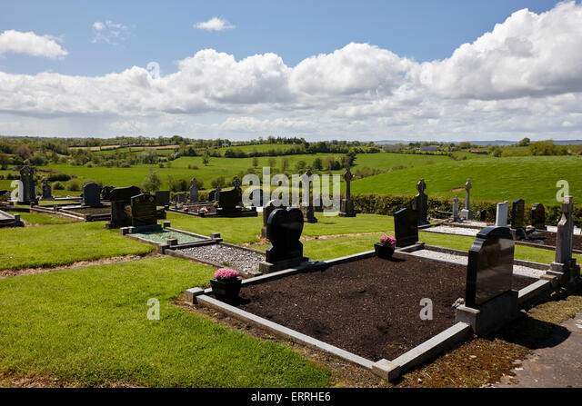 modern graveyard overlooking rural landscape in tydavnet county monaghan republic of ireland - Stock Image