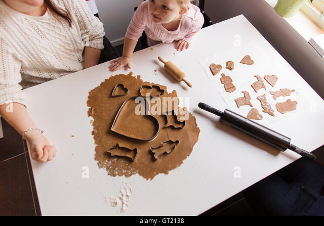 High angle view of mother and daughter preparing cookies at home - Stock-Bilder