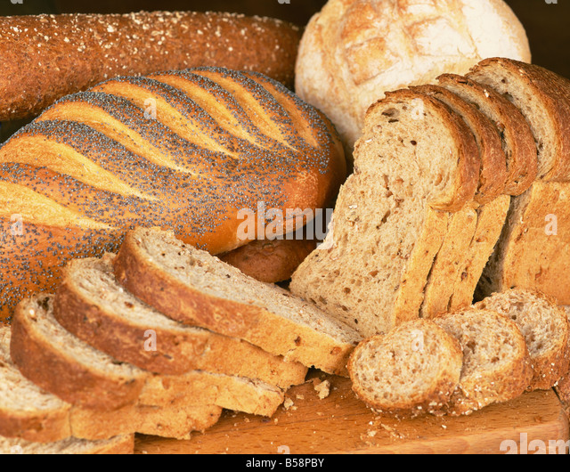 A selection of bread loaves and bread slices L Frost - Stock Image