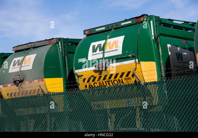 Logo signs on Waste Management, Inc., trucks in San Antonio, Texas on January 29, 2017. - Stock Image