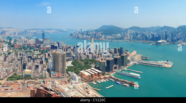 Hong Kong aerial view panorama with urban skyscrapers boat and sea. - Stock Image