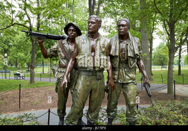 Three soldiers or servicemen statue at the vietnam veterans memorial  Washington DC USA - Stock Image