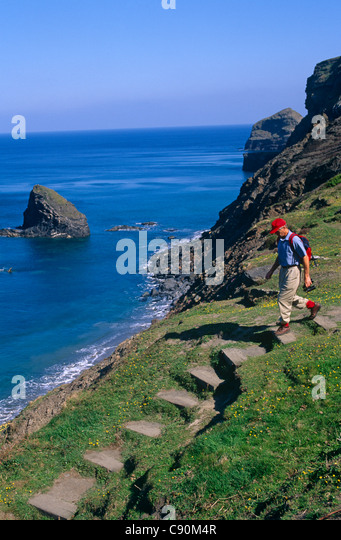 Strangles Bay is on the coastal walking route near Crackington Haven. The cliffs are sheer and there are rock pillars - Stock Image