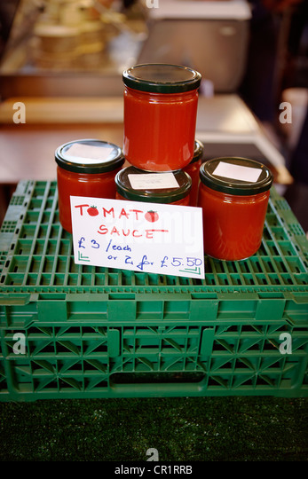 Jars of tomato sauce for sale - Stock Image