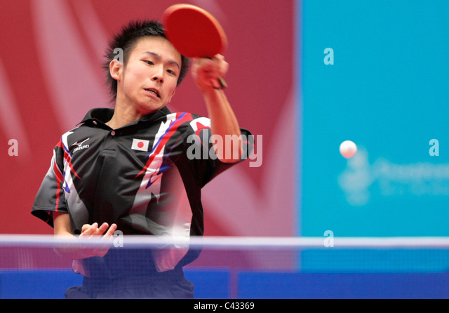 Niwa Koki of Team Japan competing in the 2010 Singapore Youth Olympic Games Table Tennis Mixed Team Finals. - Stock Image