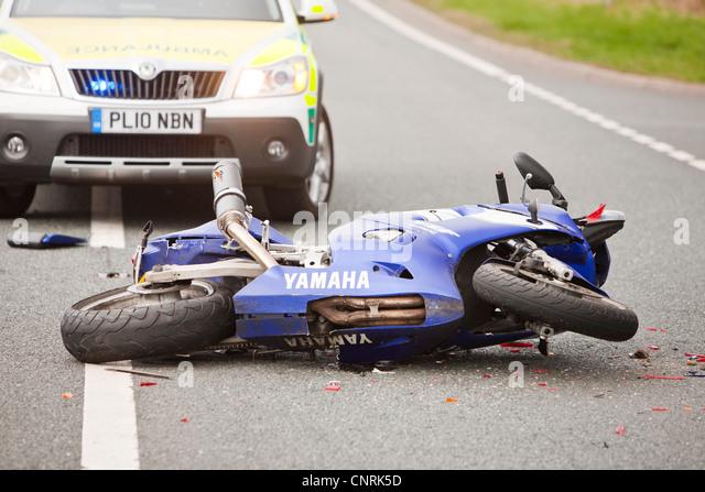 A crash on the A66 near Penrith, Cumbria, UK, involving a car and a motorbike. - Stock Image